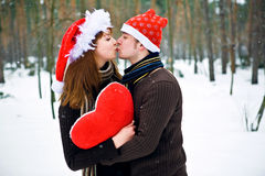 Christmas couple in love. With red heart Stock Photos