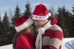 Christmas couple in love. Smiling Christmas couple in love Royalty Free Stock Photo