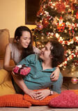 Christmas couple in love. With christmas tree decoration indoors home Royalty Free Stock Images