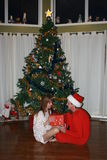 Christmas Couple. Opening gifts under a christmas tree Stock Photo