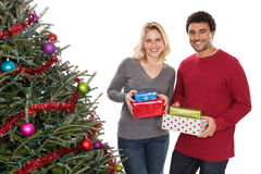 Christmas couple with presents Stock Photos