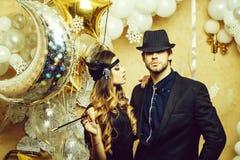 Christmas couple with star balloon