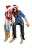 Christmas couple reading a banner Stock Images