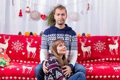 Christmas Couple on Sofa Stock Images