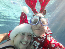 Christmas couple underwater Royalty Free Stock Photography