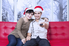 Christmas couple watching movie at home Stock Images