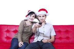 Christmas couple watching TV Stock Images