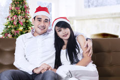 Christmas Couple wearing Santa's Hats Royalty Free Stock Photo