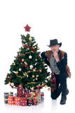 Christmas cowboy. Christmastree with presents and cowboy white background Royalty Free Stock Photo