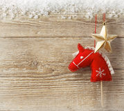 Christmas cowboy background with toy horse and star Stock Images