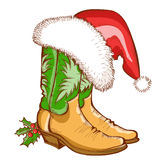 Christmas Cowboy boots and Santa hat Stock Images