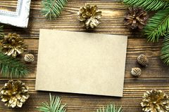 Christmas coy space, free space for invitation. Golden and green palette. Christmas card with free space for invitation on brown table background. Vintage style royalty free stock photo