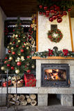 Christmas cozy interior of fireplace and christmas tree Stock Image