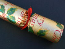 Christmas cracker. A christmas cracker on a black background Stock Photography