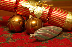 Christmas cracker and baulbaul. Three christmas tree decorations and a red and gold christmas cracker Stock Photography