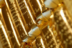 Christmas cracker blur. Close up of luxury gold christmas crackers blurred Royalty Free Stock Photography