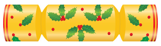 Christmas cracker decorated with holly. A golden Christmas cracker decorated with holly leaves and berries Stock Image