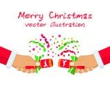 Christmas cracker in hand Santa Claus Stock Photos