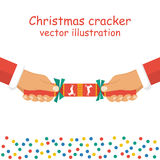 Christmas cracker holding in hand Stock Images