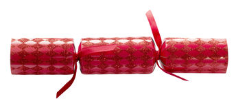 Christmas Cracker Red Isolated. Red Christmas cracker on an isolated white background with a clipping path Stock Images