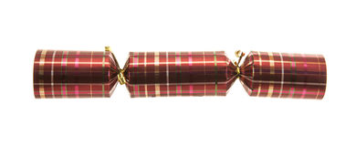 Christmas Cracker with tartan pattern. Isolated on white background Stock Photos