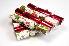 Christmas Crackers. A pile of christmas crackers against a white background Royalty Free Stock Photography