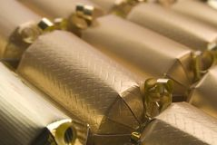 Christmas crackers. Line of Christmas crackers with shallow depth of field Royalty Free Stock Photo
