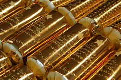 Christmas crackers. Close up of luxury gold christmas crackers Royalty Free Stock Photo