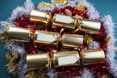 Christmas Crackers with blank labels - red, gold, silver and gre. Christmas Crackers with tinsel and pine cones stock photo