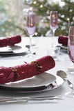 Christmas Crackers On Dining Table Royalty Free Stock Photo