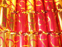 Christmas crackers gold and red. Lined up Royalty Free Stock Photos