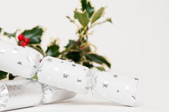 Christmas crackers with holly leaves Stock Images