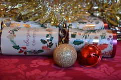 Christmas crackers with ornaments Stock Photography