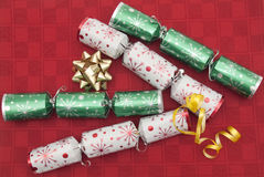 Christmas crackers on red background Royalty Free Stock Photos