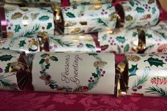 Christmas crackers on table Stock Photo