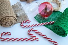 Christmas craft. Ornament ball, candy canes stock photography
