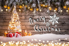 Christmas crafted decoration on wooden background. Stock Images