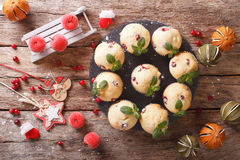 Christmas cranberry muffins decorated with mint closeup. horizon Royalty Free Stock Images