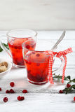 Christmas cranberry tea on the boards Stock Image