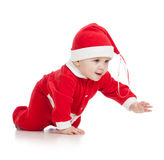 Christmas crawling baby. Crawling baby boy in Santa clothes royalty free stock photos