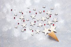 Christmas creativity concept with cranberries and stars in the waffle cone sprinkled with powdered sugar. Flat lay, Close-up. Top view on light wooden table royalty free stock photos