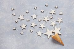 Christmas creativity concept with white wooden stars in the waffle cone. Flat lay, Close-up, top view on light wooden table. Place for your text stock photography