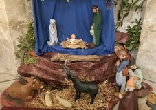 Christmas creche with Joseph Mary and small Jesus. Scene of christmas creche with Joseph Mary and small Jesus stock images