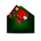 Christmas credit card in green envelope  over white Stock Image