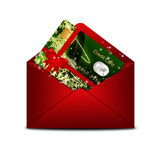 Christmas credit card in red envelope  over white Royalty Free Stock Image