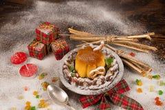 Christmas creme caramel with decoration stock photos