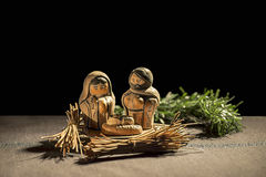 Christmas Crib. Figures of Baby Jesus, Virgin Mary and St. Josep. H over a black background Stock Photography