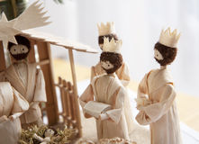 Christmas crib and three wise men. Giving gifts to Jesus baby royalty free stock photos