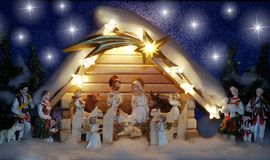 Christmas crib. In the wooden shed are: baby Jesus in his crib, Mary and Josef with angels, shepherds, sheep, lambs , cow and donkey Royalty Free Stock Images
