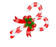 Free Christmas Crossed Red Striped Lollipops Decorated With Bow And Mistletoe Royalty Free Stock Photography - 164257827